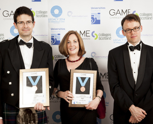 Simon Mackenzie, Michele Burman and Niall Hamilton-Smith collecting Bronze Medal at awards ceremony 2014.